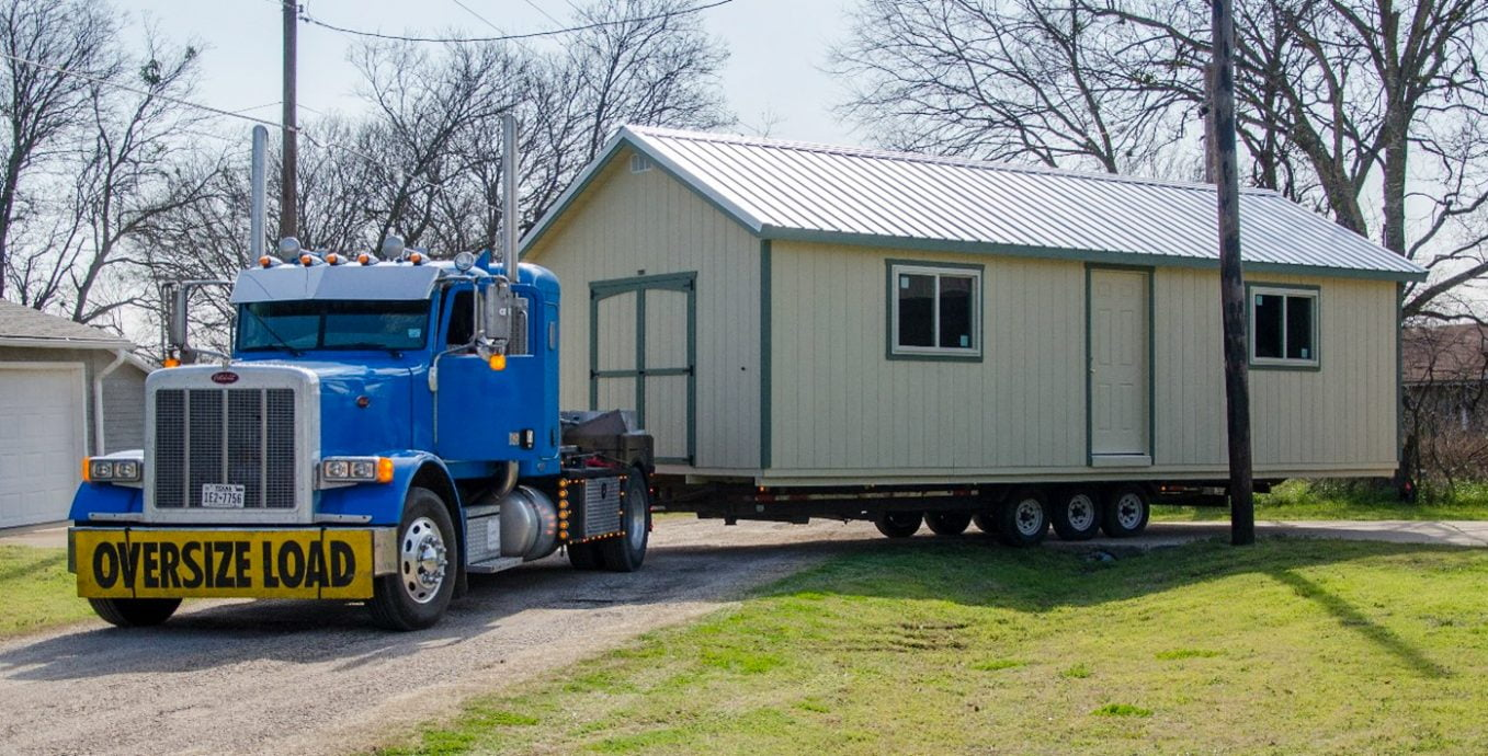 Shed hauler moving a portable storage building in texas
