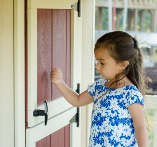 Child knocking on door ofkids playhouses for sale in texas